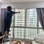 cleaner is wiping the window panels